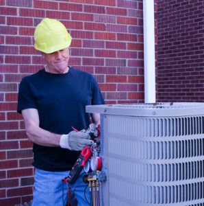 technician performing AC repair""