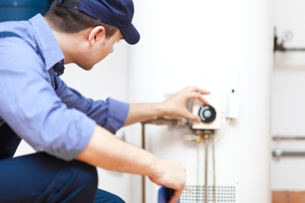 technician performing heating repair