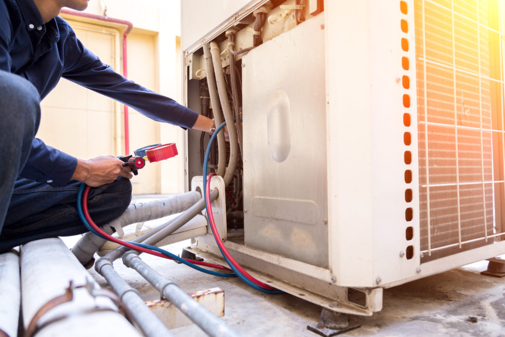 Technician is checking air conditioner and heater maintenance ,measuring equipment for filling air conditioners.